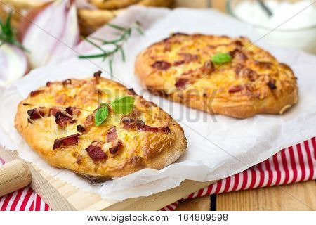 German pizza style tart flambee Swabian Dinnete with onions and bacon