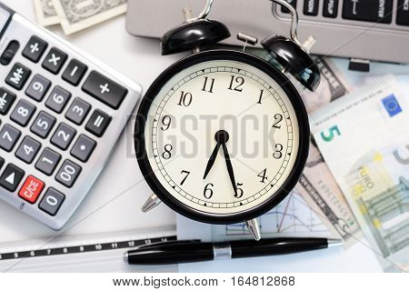 Deadline concept suggesting job stress without time management with retro alarm clock and office tools