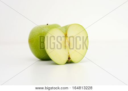 Healthy eating diet suggested by green apples isolated on white background