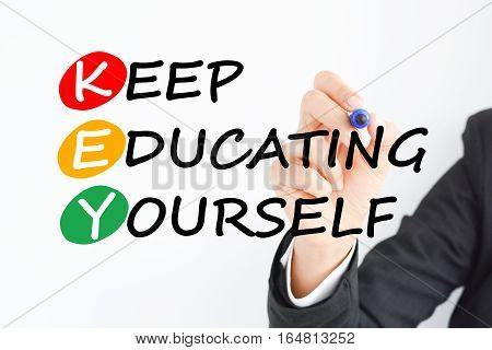 Keep educating yourself business concept acronym suggesting that education is the KEY to success