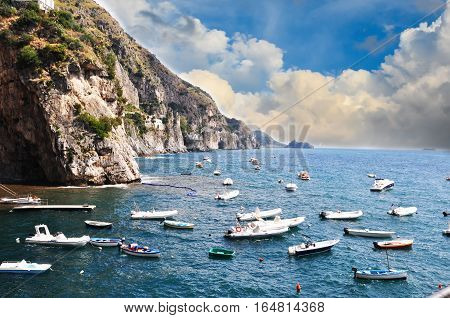 Small vessels sailing along the coast line in Praiano, Amalfi Coast - Italy