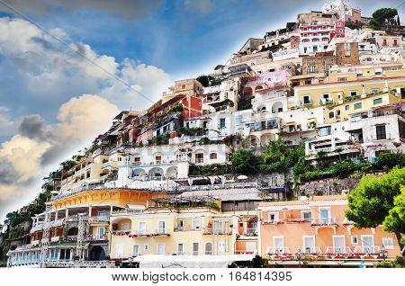 Colorful houses built on seaside cliff in Positano, Amalfi Coast