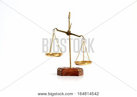 Golden brass scale isolated on white background