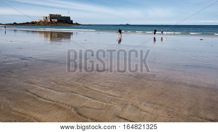 Low tide and endless sand beach in Saint-Malo, Bretagne France