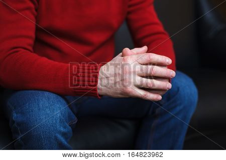 Man Crossed His Fingers. Patiently Wait For An Answer