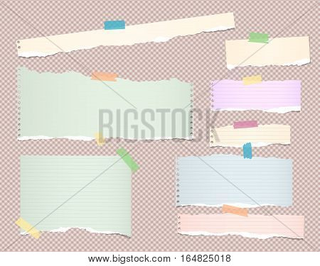 Pieces of pastel color, different size ripped note, notebook, copybook paper sheets stuck with coloful sticky tape on squared pattern.