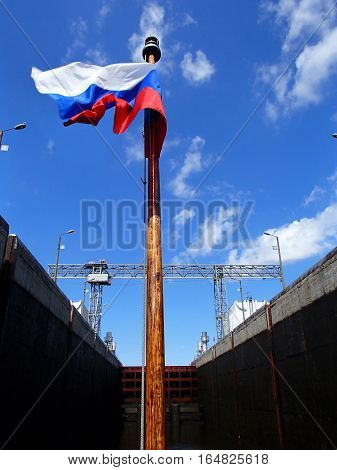 MOSCOW REGION RUSSIA - JULY 2015: Russian flag on the stern of the vessel standing in the chamber closed gateway
