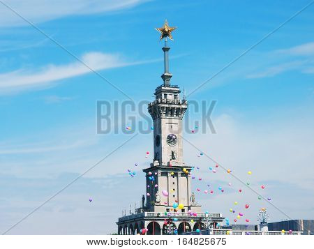 MOSCOW RUSSIA - JULY 2014: The spire of the North River Station surrounded by balloons. The station was built in 1937 it is an architectural monument and one of the symbols of Moscow.