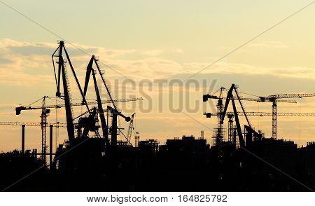 NIZHNY NOVGOROD RUSSIA - JUNE 2016 Silhouette of construction at sunset. Construction of the stadium at Strelka in Nizhny Novgorod. Football facility for the World Cup 2018 in Russia.