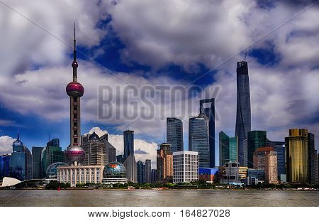 Shanghai China.Shanghai Pudong landmark skyline in cloudy weather China. Shanghai has been developed specifically as a new financial district of China.