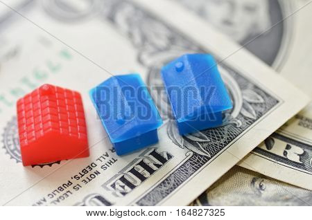 Little Plastic House On Us Dollar Banknote