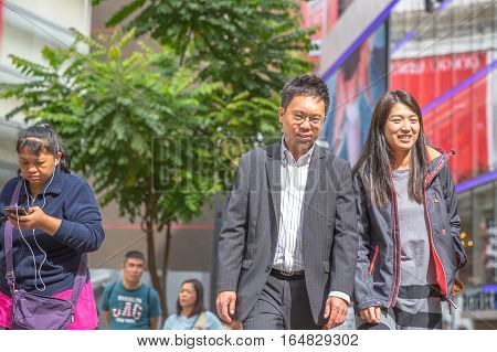 Hong Kong, China - December 6, 2016: asian couple walking for shopping in Jardine's Crescent street market, Causaway Bay, district full of luxury shops of famous brends.