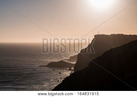 Portugal - Sun Setting Behind Cliffs