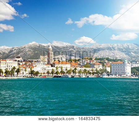 View of Riva and Old Town Split in Dalmatia region, Croatia. Ancient Diocletian's Palace on a Sunny Summer Day. Popular Tourist Destination at Adriatic Sea. Mediterranean Europe Travel Concept.