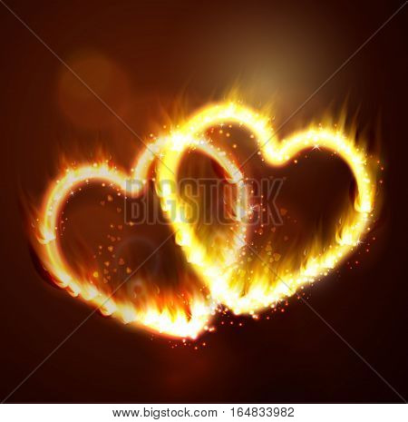 two flame hearts on the dark background yellow and magic