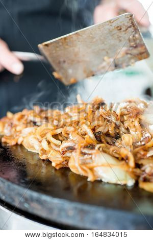 Closeup Of Cooked Onions On Hot Skillet