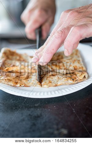 Crepe In Paper Plate Cut With A Knife