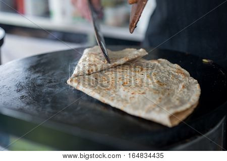 Crepe On Hot Skilet Folded For Serving