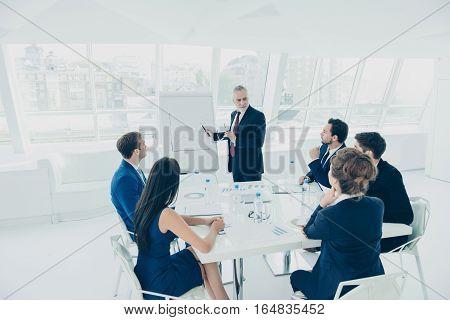 Senior Partner Near Flipchart Making Presentation About Growth Of Company