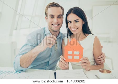 Portrait of happy young family buying new house