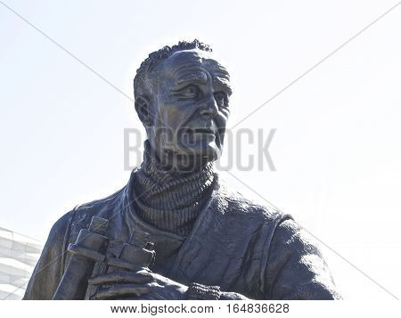 Captain Johnnie Walker statue at Liverpool docks over blue sky, uk Britain, England poster