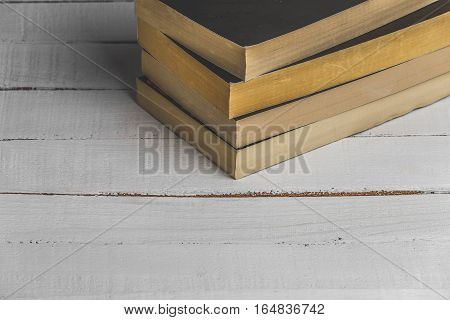 Wooden Bookshelf with old books. Close up image with copy space. Top view