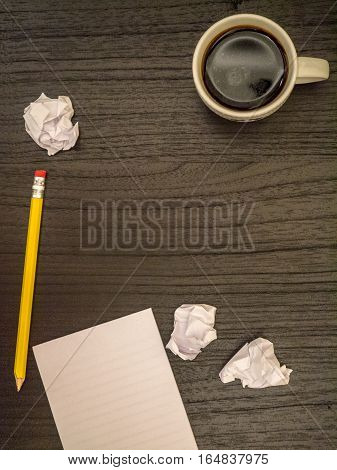 Dark surface paper wads pencil coffee black