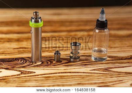 Parts Of E-cigarette And A Jar With Fluid For Personal Vaporisers. Electronic Nicotine Delivery Syst