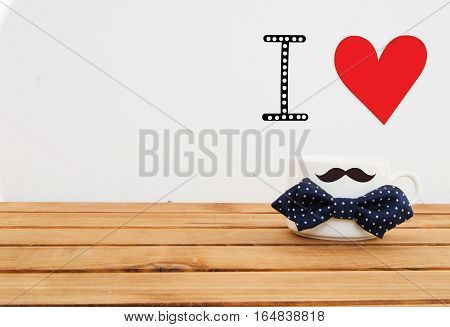 White mug on wooden background with mustaches and hand drawn lettering. Father's Day funny greeting card concept