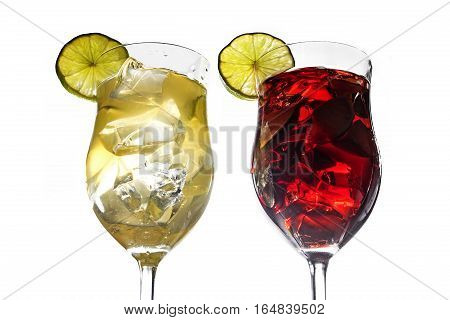 Two cocktail glasses with white and red mixed drinks from lime cherries berries grapefruit and ice with or without alcohol isolated on a white background selected focus narrow depth of field