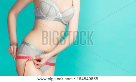 Woman Measuring Her Hips With Measure Tape