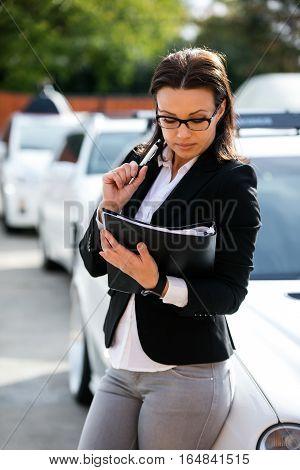 Business brunette woman portrait on a drive way