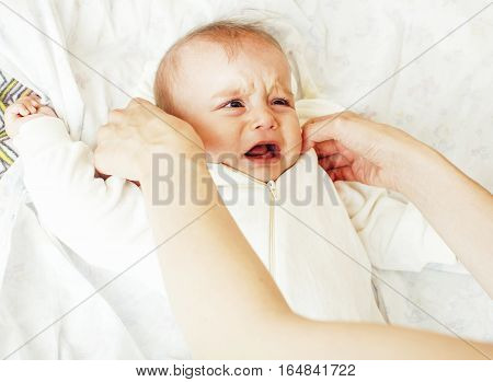 Mother carrying clothers for baby todler little son crying, unhappy, mom with kid daily routine, lifestyle people concept close up