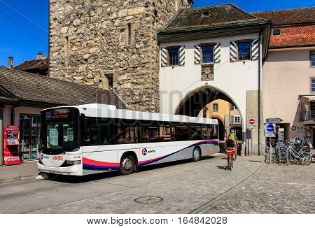 Aarau, Switzerland - 7 July, 2016: a Hess bus at a bus stop in the old town. Hess is a brand of Carrosserie Hess AG - a bus, trolleybus and commercial vehicle manufacturer, based in the town of Bellach, Switzerland.