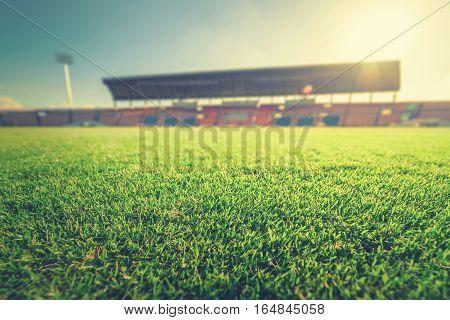 Green grass in soccer stadium. vintage tone.