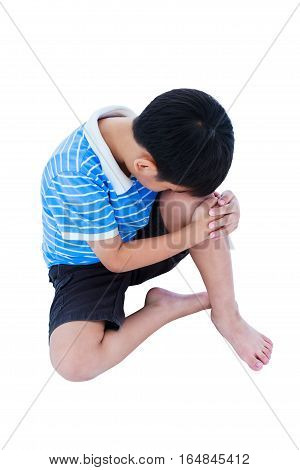Full Body Of Sad Boy Barefeet Sitting On Floor. Isolated On White Background.