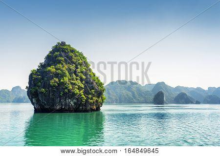 Beautiful Karst Isle On Blue Sky Background In The Ha Long Bay