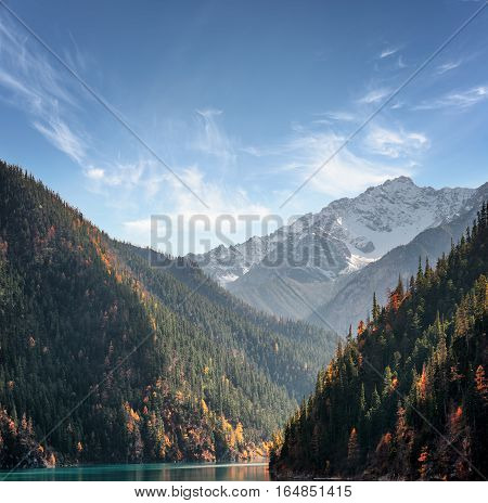 Snow-capped Mountains On Blue Sky Background. Amazing Landscape