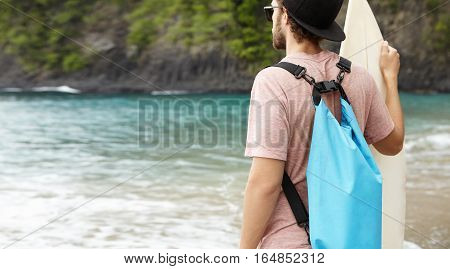 People, Leisure, Holidays And Adventure Concept. Outdoor Shot Of Fashionable Male With Blue Bag And