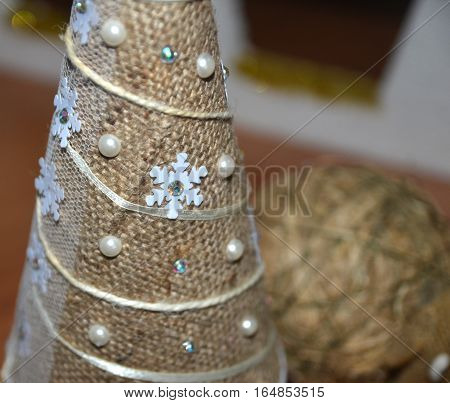 Hand made Christmas tree made of bagging and pearls