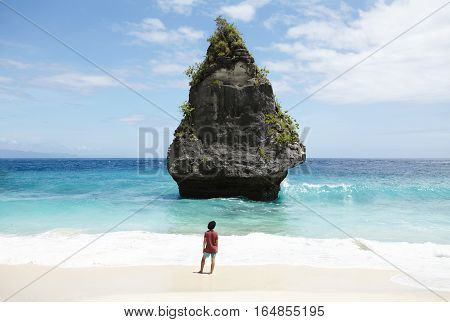 Travel, Adventure, Hobby And Vacation Concept. Casually Dressed Young Man In Black Hat Walking Along