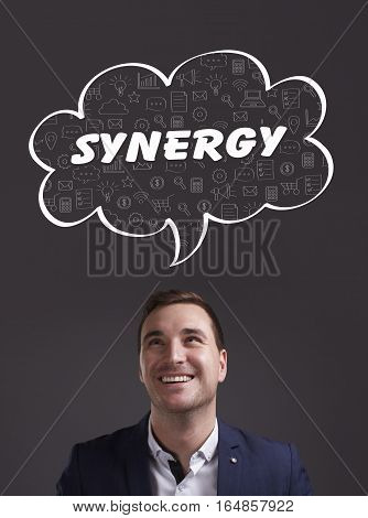 Business, Technology, Internet And Marketing. Young Businessman Thinking About: Synergy