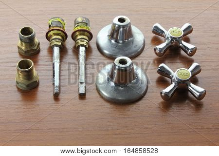 Taps and Accessories on a Wooden Background