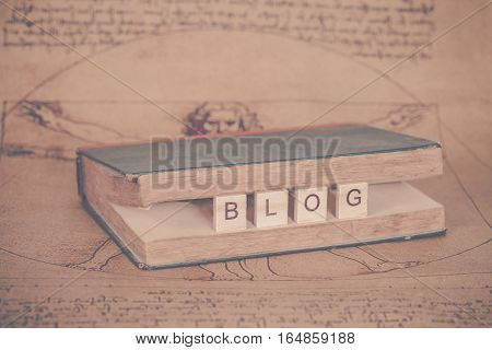 word written on wood block in the vintage book .