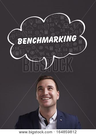 Business, Technology, Internet And Marketing. Young Businessman Thinking About: Benchmarking