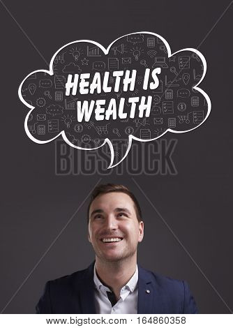 Business, Technology, Internet And Marketing. Young Businessman Thinking About: Health Is Wealth