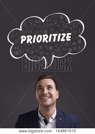 Business, Technology, Internet And Marketing. Young Businessman Thinking About: Prioritize