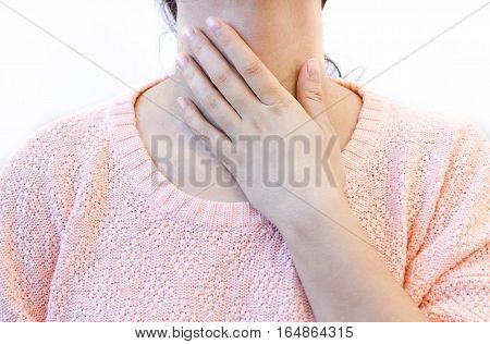 woman with throat pain thyroid gland control. female touches her neck white background.