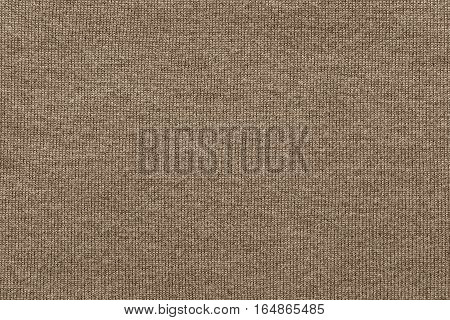 woven texture of woolen fabric or yarn closeup for a background or for wallpaper of brown color