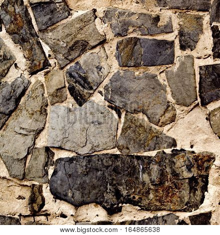 Stone background, stone texture, stone wall, old stone wall. Grunge stone background. Grunge background. Grunge. Handmade stonewall.